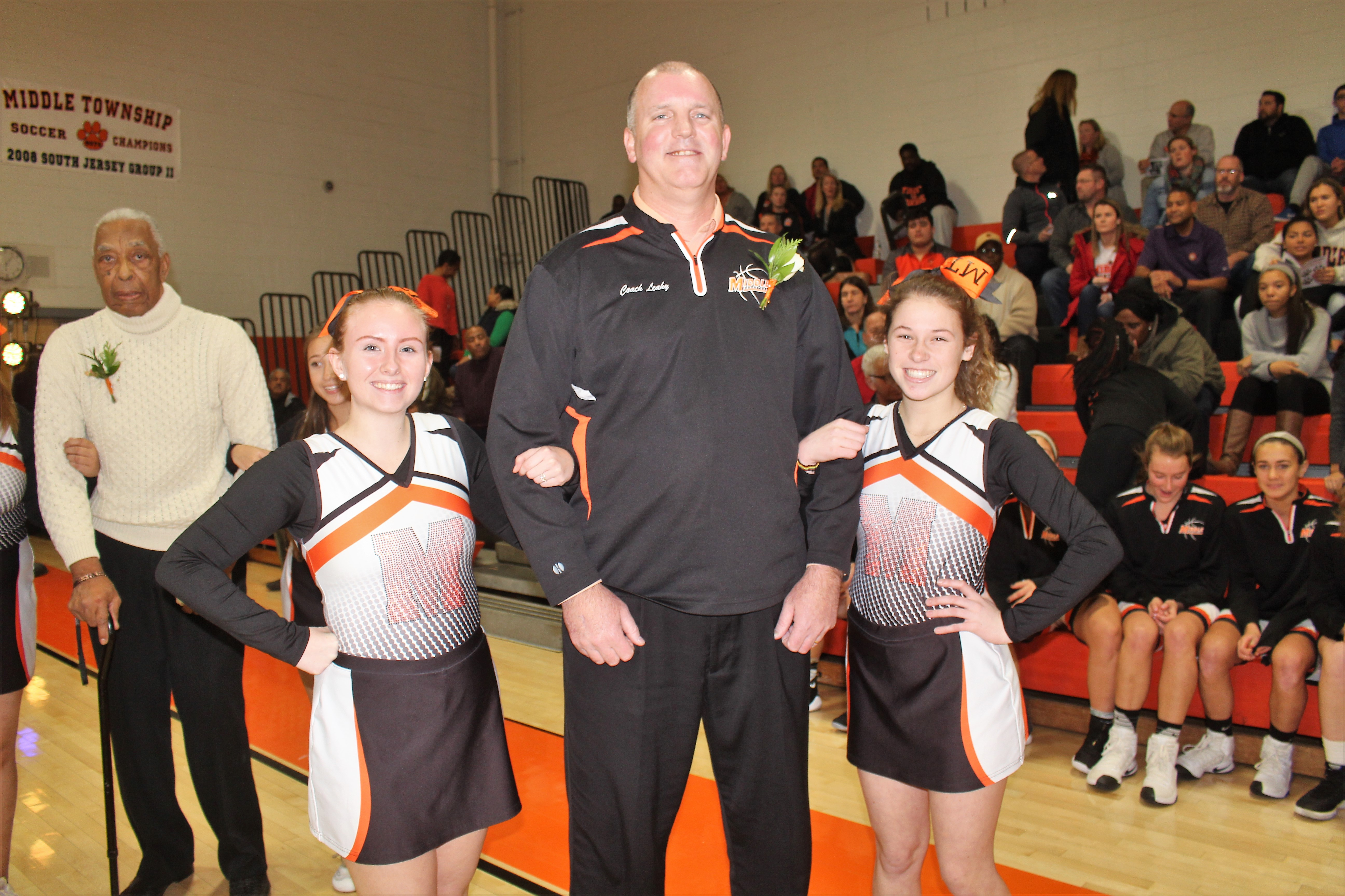 1eadf465a3 John Leahy is escorted by a pair of Middle Township High School  cheerleaders.